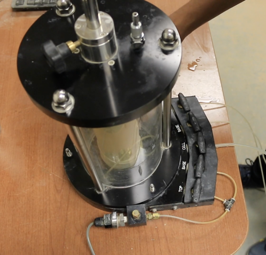 A person is setting the triaxial apparatus