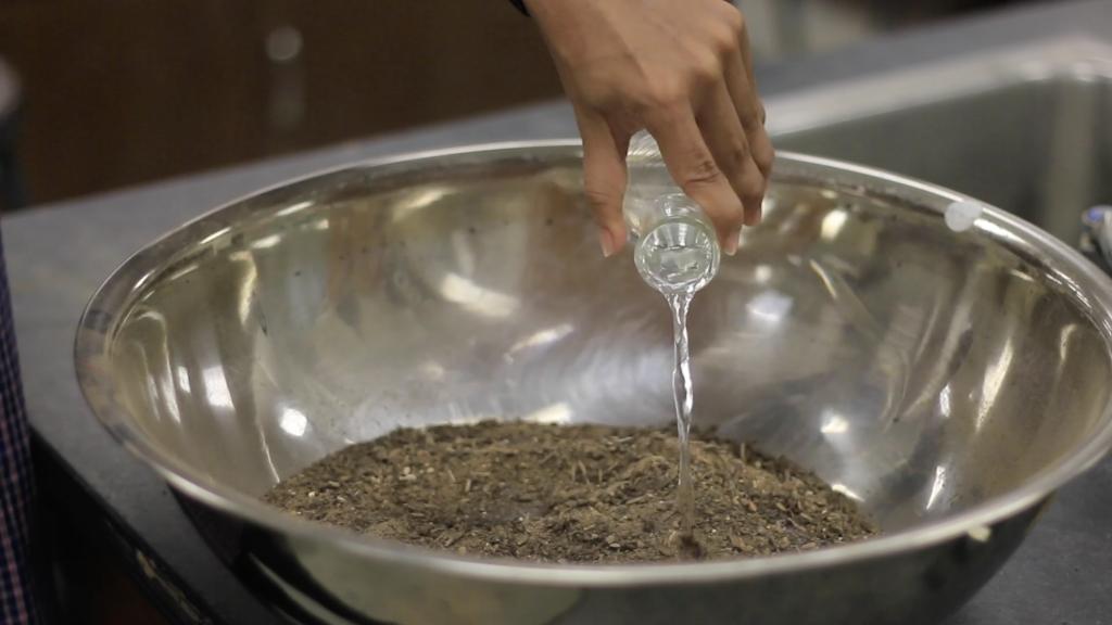 Adding water to soil sample