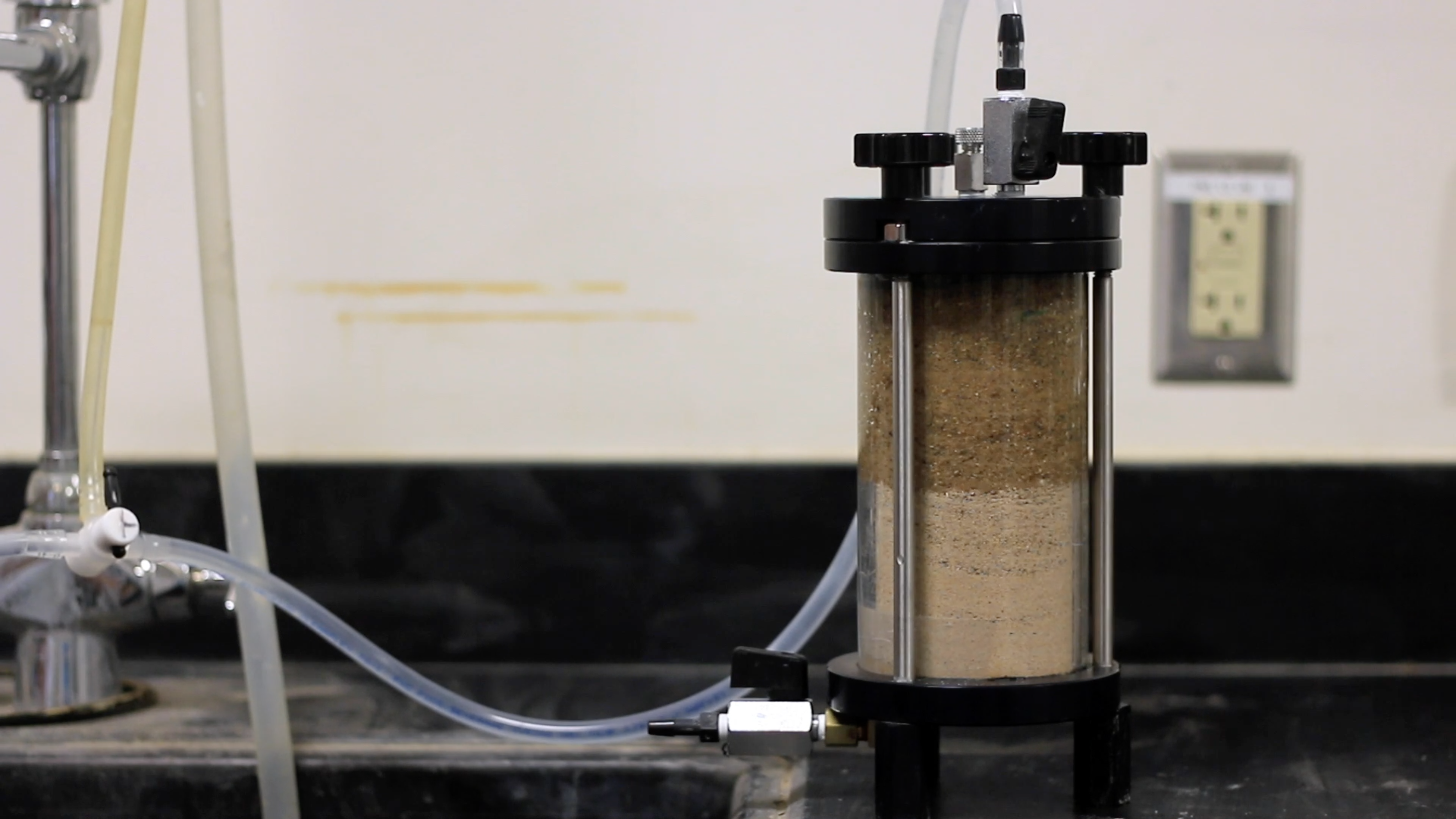Saturation of soil sample prior to the test