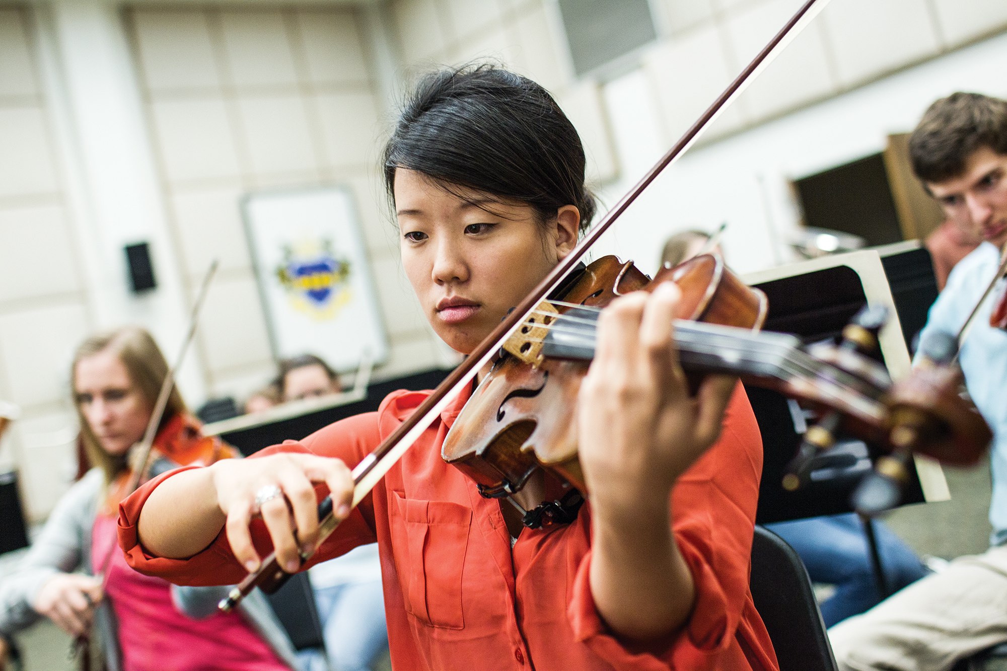 Student playing a Violin in a music class