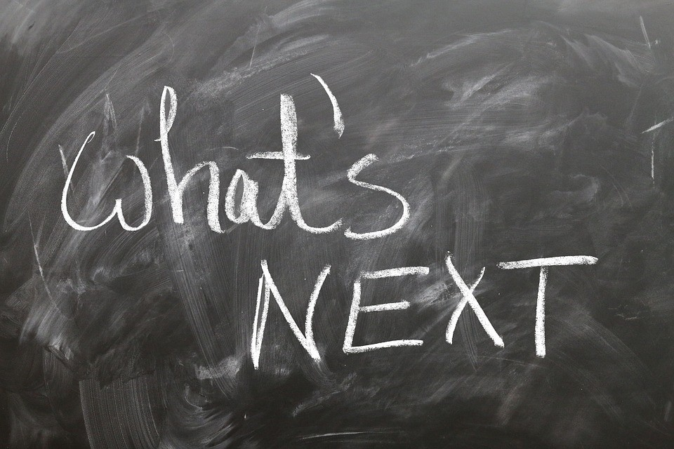 "a chalkboard with ""what's next?"" written on it"